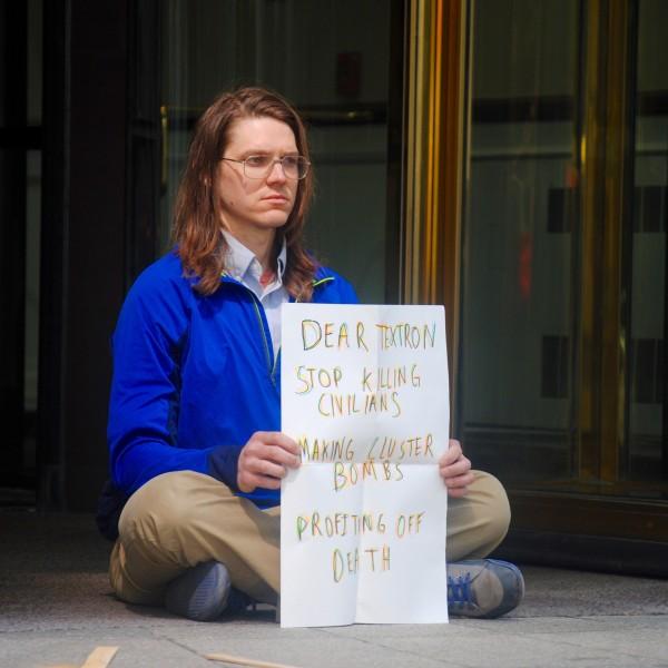 Mark protesting at Textron World Headquarters, Providence, RI