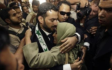 Muntadhar al-Zaidi embracing his sister upon his release from prison, January 2010