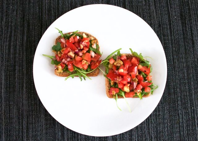 white plate with two slices of homemade bruschetta toast on it