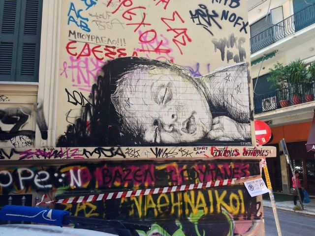 Drawing of a child sleeping on an Athens Street amid graffiti