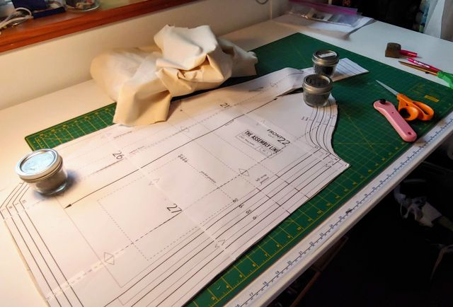 Photograph of sewing pattern and scissors.